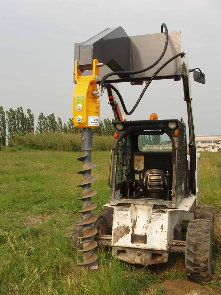 Augers for skid loaders VIDEO http://www.youtube.com/watch?v=OrsTTEY5O6Q