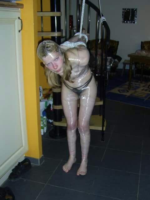 Plastic wrap bondage girl