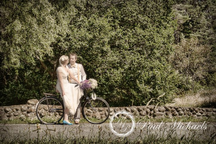 Wedding couple on the bike in the park. Silverstream retreat venue. PaulMichaels wedding photography Wellington http://www.paulmichaels.co.nz/
