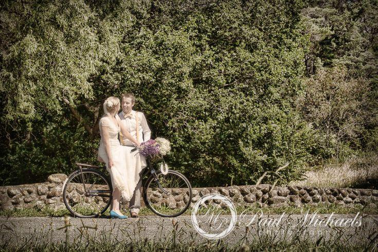Wedding couple on the bike in the park. Silverstream retreat venue. PaulMichaels wedding photography Wellington http://www.paulmichaels.co.nz/