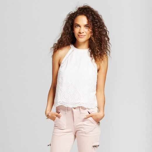 Dainty and delicate, this White Sleeveless Top from Mossimo Supply Co.™ will pair perfectly with your light and airy style. The halter-neck design along with the flowy construction will keep you ready for anything that comes your way this season. Pair it with pastel-colored pants or light-wash jeans to round out your look.