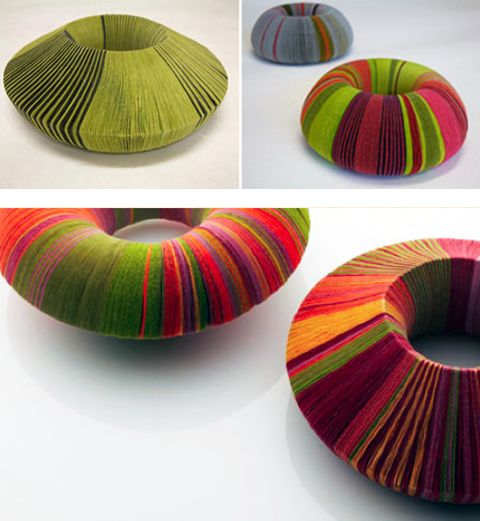 Angela O'Kelly, Contemporary paper jewelry. O'Kelly is a designer maker who crosses boundaries of jewellery, textiles and sculpture. She combines paper with mixed media using a variety of traditional and non-traditional textile and jewellery techniques. Inspiration derives from a fascination with simple shapes, textures, repetition and colour in urban and rural landscapes. See her site at: http://www.angelaokelly.com/  And on PaperPhine's blog: http://www.paperphine.com/?p=2834