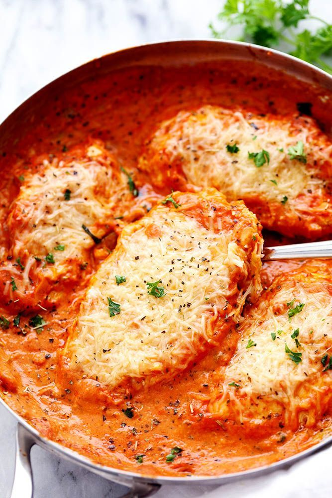 Creamy Tomato Italian Parmesan Chicken - chicken in a creamy red tomato sauce and covered in melty Parmesan cheese!