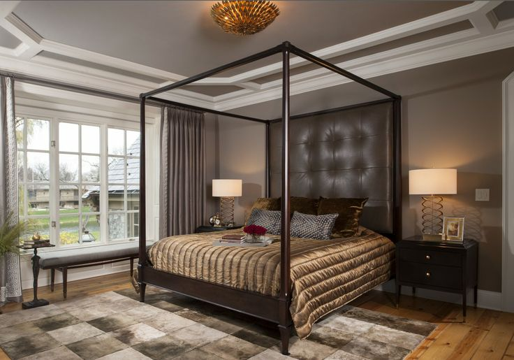 contemporary bedroom with large poster bed and wood plan floor