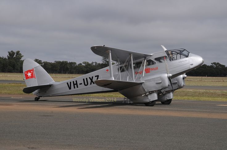 A slightly different angle on Dragon Rapide VH-UXZ, beautifully restored. AAAA Temora national fly-in 2014.