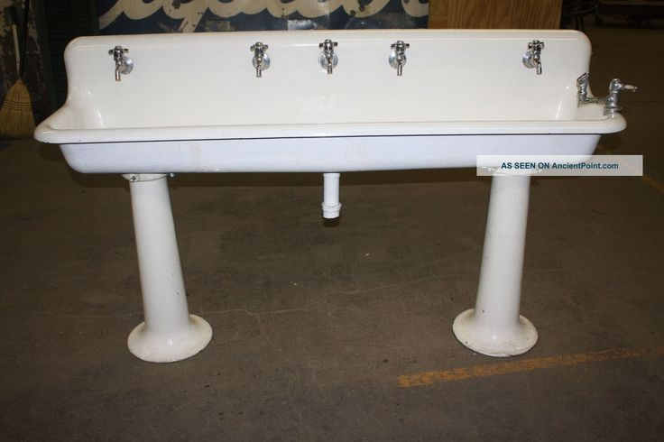 Old school industrial porcelain gang sinks on pedestal for Pedestal sink with metal legs