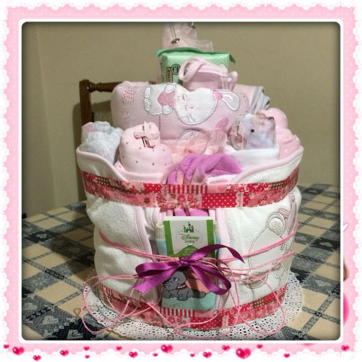 Welcome baby diaper and onesies cake