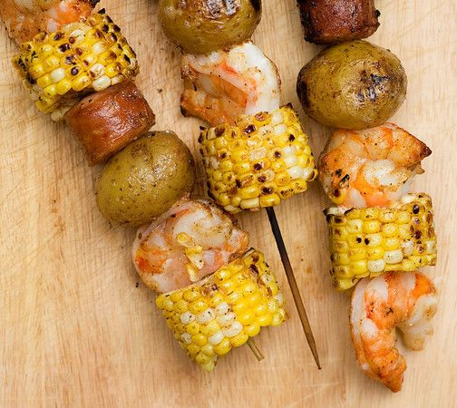 Low Country Boil Kabobs.   Thread onto skewers : boiled potatoes,uncooked shrimp,chunks of sausage and pieces of corn (use a nail to make hole in middle) Brush with melted butter and Old Bay Seasoning. Put on grill turning for as long as it takes for shrimp to cook 5 to 8 minutes( shrimp will become pink). Do not over cook