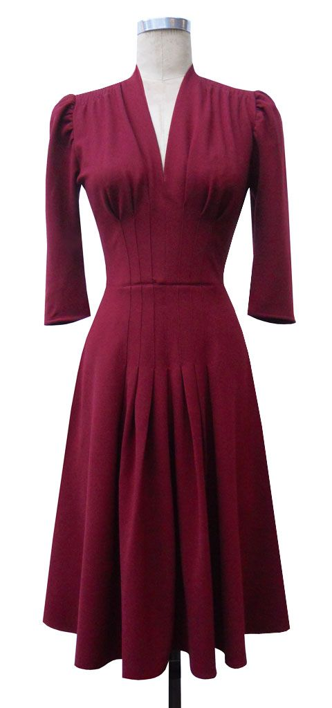 Jenny Dress features a v neckline and classic gathered top 1940's 3/4 length sleeves. The darts extend from under the bust to the fullness of the hips . There is gathering at the top of the shoulder and the skirt has a kicky wide a-line shape.