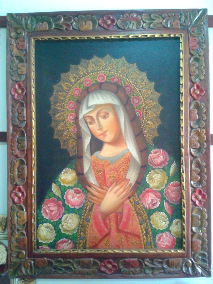 Óleo Virgen. marco talla en madera.