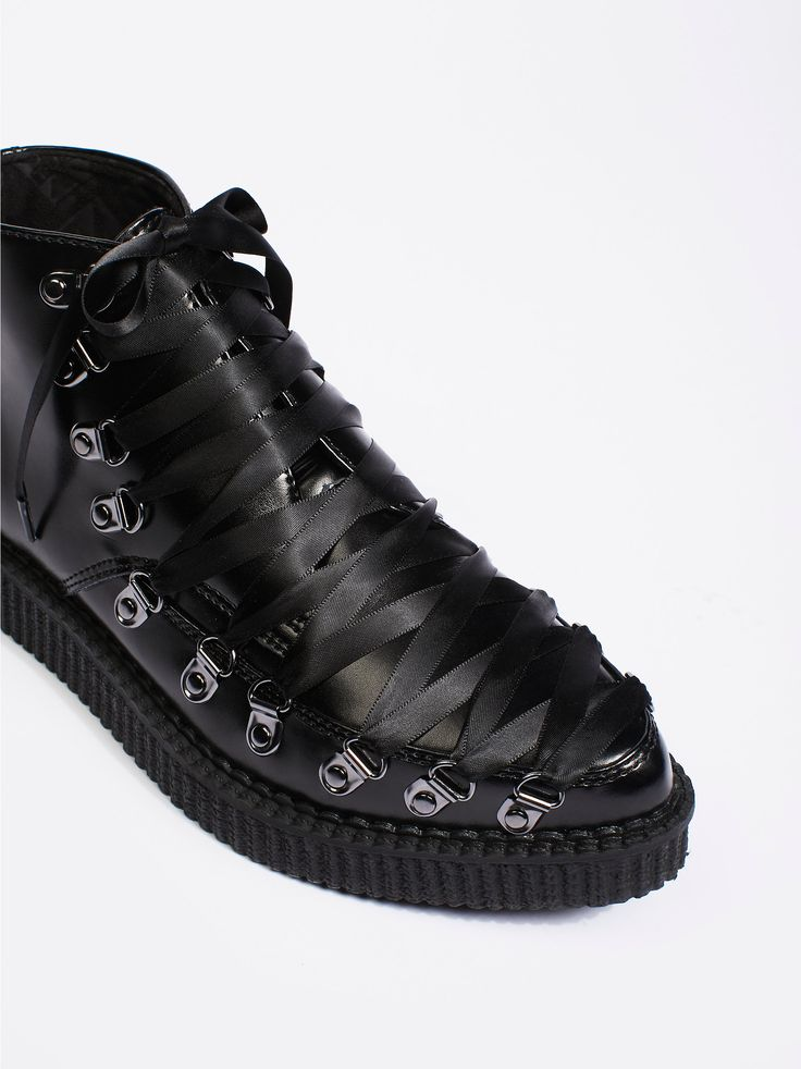 T.U.K Corset Creeper Boot | Edgy and rugged leather creeper boots featuring corset-inspired laces.    * Ridged platform   * Padded footbed   * Pointed toe    **Fit** This style is in unisex sizing so a men's size 4 is a women's size 6.