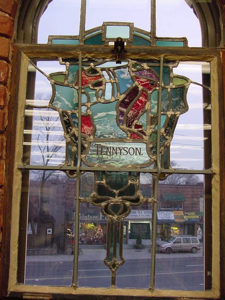 Weston Branch - Toronto Public Library - Tennyson stained glass window by Robert McCausland Limited. Architect Lindsay & Brydon, a Toronto firm, designed a simple Arts and Crafts style library, enriched by stained-glass windows and Art Nouveau mosaic panels - a unique feature among the Ontario Carnegie libraries.
