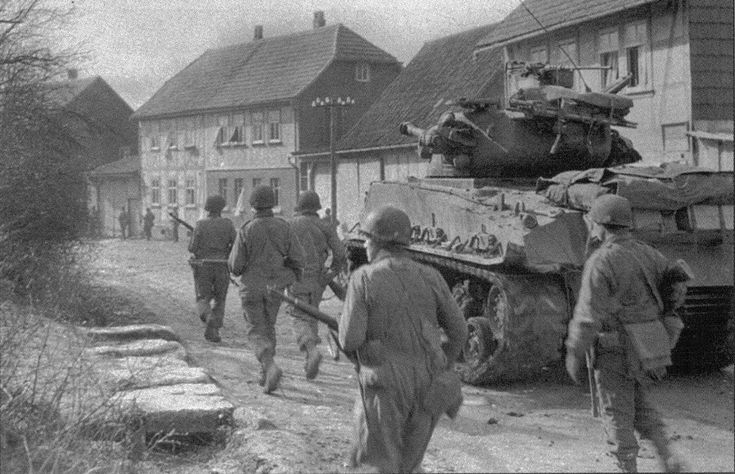 A Sherman tank of the 6th Armored Division entered the city Oberdrola German…