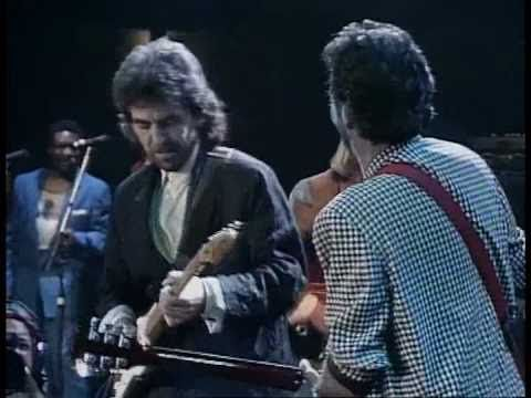 George Harrison, Ringo, Eric Clapton, Elton John (piano) and others  - While my guitar gently weeps (HQ) - YouTube  -- a star studded AWESOME performance!!!