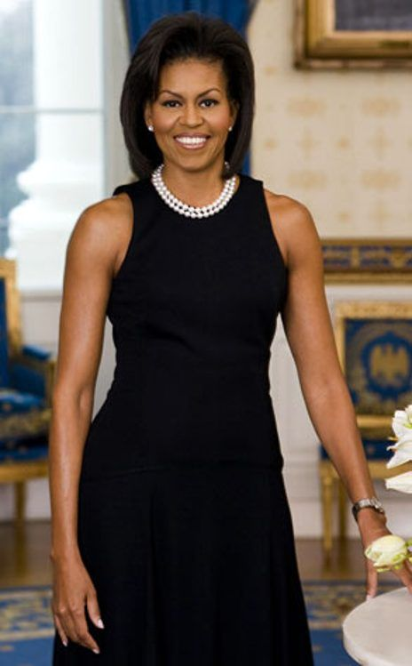 MICHELLE OBAMA, WHITE HOUSE PORTRAIT  The first lady poses for her official White House portrait in the famed Blue Room, wearing ablack Michael Kors shift and classic double-stranded pearls.