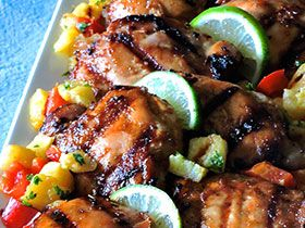 This chicken is dressed to grill with honey, lime, Asian chili sauce, fresh gingerroot and spices that transform boring chicken thighs or drumsticks.