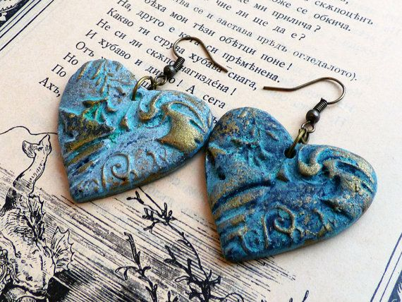 These eye-candy earrings were created using a technique involving metal coating and oxidizing agent to create the real patina that you see. They were stamped, cut, and sanded by hand. The hearts measure 1.5 in x 1.5in or 3.8cm x 3.8cm approx. The wires are in a matching color. The hearts have been varnished to protect the, from external conditions. All my items are created with the greatest care to detail. = About polymer clay = Polymer clay is a relatively new material. It is sol...