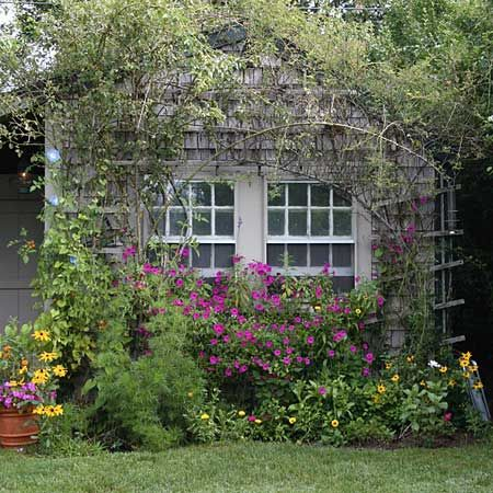This classic cottage garden displays a harmonious mix of annuals, perennials, roses, shrubs, vines—even vegetables—in neatly tended arrangements designed to delight, rather than impress.   Photo: Nancy Andrews   thisoldhouse.com