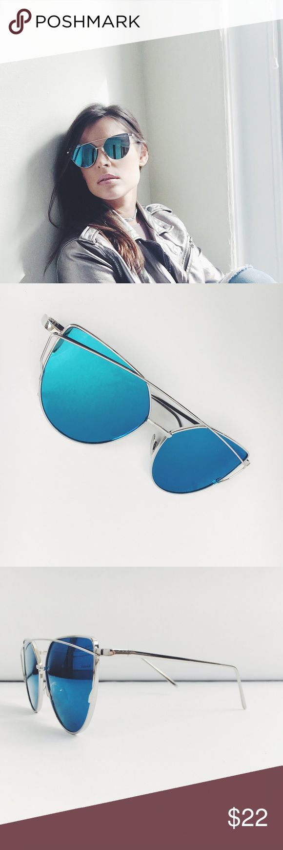 Blue & Silver Cat Eye Aviator Mirrored Sunnies NWT boutique item. Trend Alert❣ Cat Eye Aviator Sunnies! Silver Frame & Blue Lens. Material: Polycarbonate, Frame Material: Copper. Lens Optical Attributes: Mirror, UV400, Anti-Reflective. Other colors available, Please contact me for other colors Accessories Sunglasses
