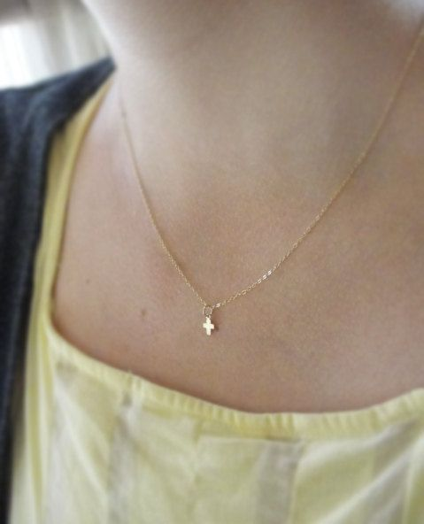 Tiny little gold cross necklace