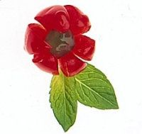 To make cherry flower garnishes:  Place a cherry on cutting board. Cut it into six wedges with a sharp paring knife, being careful not to cut through bottom third of cherry.  Use the tip of the knife to gently separate and spread the cherry segments.  If desired, place a tiny piece of candied fruit or peel in center of flower and accent with leaves of fresh mint.