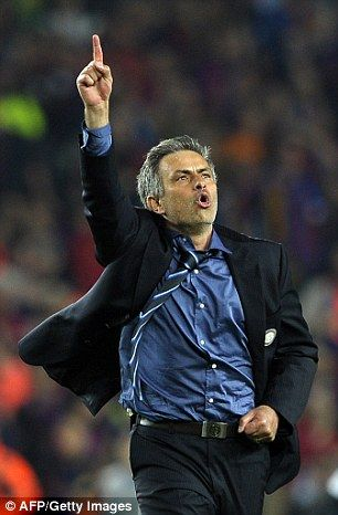 Jose Mourinho celebrates defeating Barcelona with his Inter Milan team in 2010
