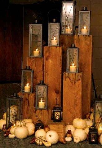 Fabric-covered pillars with lanterns and candles