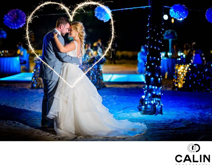 Photography by Calin - Barcelo Maya Palace Deluxe Wedding - Sparklers Heart:  This is one of my favourite sparklers bride and groom portraits captured during a Barcelo Maya Palace Deluxe wedding. At the time when this article was written, the sparklers photographs were a bit of a trend.