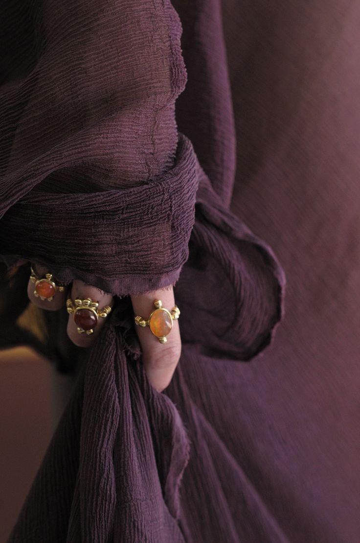 Alex wears new Katy Rodriguez Fire Opal Rings.