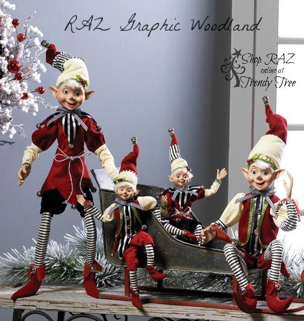 "RAZ Elves Set of 2 Assorted elves Set includes one of each style Red, Black, Cream Posable Made of Polyester Measures 30"" Measured from toes to outstretched hats For decoration only - this is not a toy Not intended for children RAZ Exclusive *Additional image shows other smaller elves which are not included. RAZ 2015 Graphic Woodland Collection"
