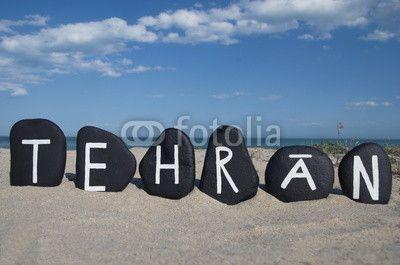 Teheran, capital of Iran, souvenir on black stones with beach background