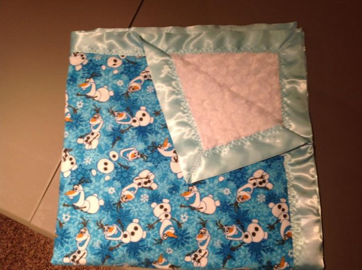 Blue Olaf with white rose and light blue trim. 36x36""
