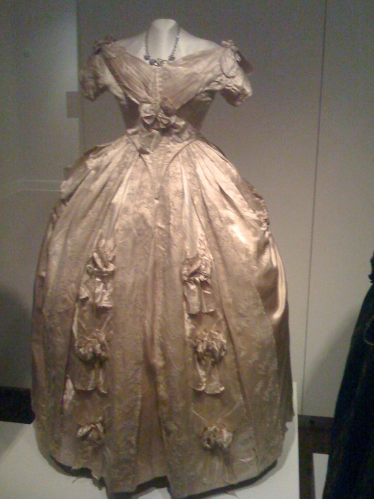 "From ""Sarah Polk, First Lady of Style"" exhibit; Columbia, TN. The exhibit states ""In 1847, she ordered the cream silk satin with silk lace ball gown from Madame Oudot Manoury, one of the most fashionable couturiers in Paris, France."" The Sarah Polk fashion exhibit runs through July, 2013."