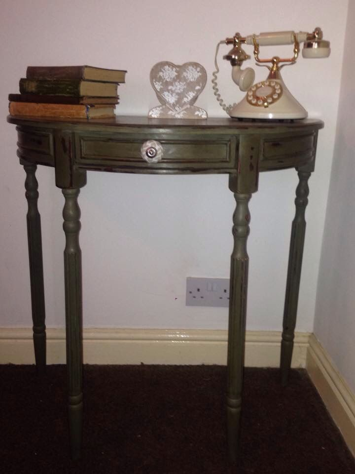Half moon console table/telephone table. Painted in Olive. Heavily distressed and heavily waxed using dark wax. Perfect little piece for a hallway.