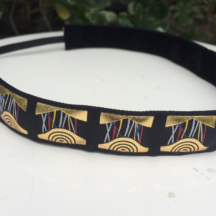 A personal favorite from my Etsy shop https://www.etsy.com/listing/270316555/gold-droid-running-headband-78-inches