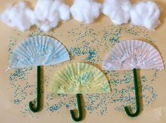 Rainy Day Umbrella Preschool Craft  What You Need  Sheet of Paper – any will do  Glue  Scissors  Cotton Balls (or even marshmallows!)  Blue Colored Sugar (or glitter if you have it)  Baking Cups (cupcake papers)  Chenille Stems (or tooth picks, spaghetti noodles, etc. for the handle)
