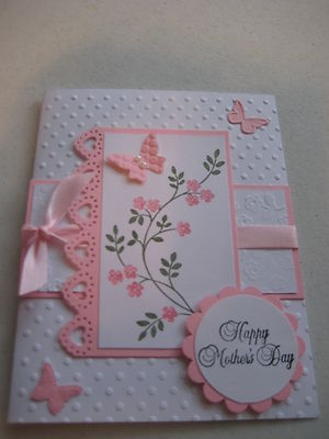 like the embossed background, the layout, the heart border, and a touch of ribbon.....like it all.