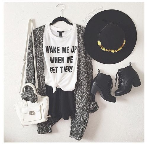 Loving this chic outfit! Gray marble cardigan, white graphic tee, and black shorts paired with black booties and a fedora!