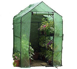A walk-in greenhouse with shelves that I can assemble anywhere I need it!  Genuis!  :-)