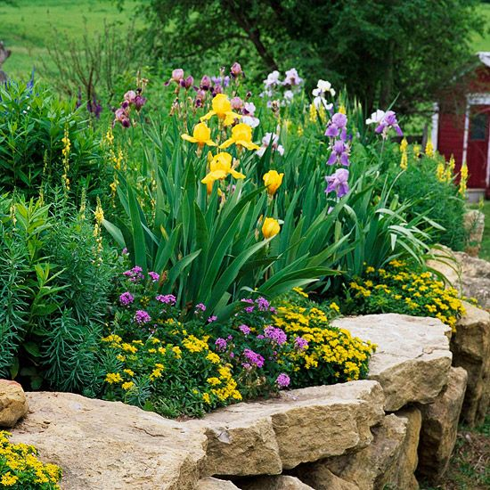 We have a retaining wall in the backyard, not a beautiful dry stack like this though. I'd like the plants to mimic this.