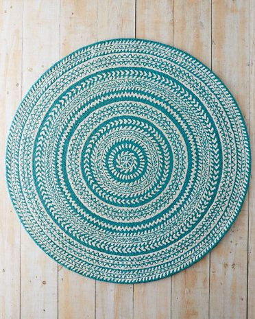 Our round Fair Isle Hooked Wool Rug adds a unique touch to any room with bands of Highland-style designs.