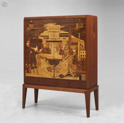 """Superb Swedish craftwork, Cabinet furniture in mahogny, made 1942, with documentation, """"original certificate"""", stating that the cabinet was designed by Swedish Arhitect Erik Matsson, and that this specific Cabinet is marked number 1 out of 12 handmade. Carpenter Harry Carlsson built this cabinet furniture. The Intarsia at the front picturing the classical skyline and symbols of Gothenburg. Dimensions: 135 cm x 99 cm x 37 cm. In very good condition: hans.borgelin@tele2.se"""