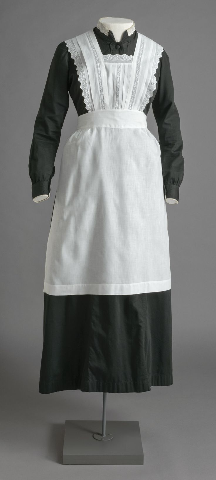Maid's morning uniform worn by Anna on Downton Abbey. Cosprop Ltd., London. All Rights Reserved.