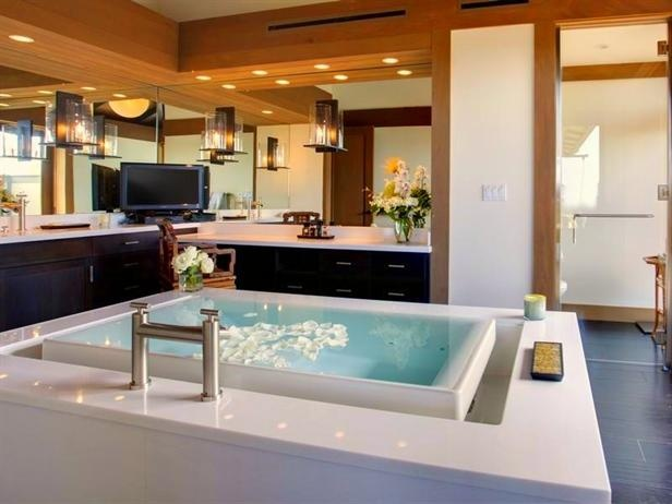 Magnificent views of the Pacific Ocean, Kohala Mountains and Mount Hualalai -- as well as the home's landscaped Japanese gardens and tranquil water features -- can all be seen and enjoyed from the relaxing master bath.