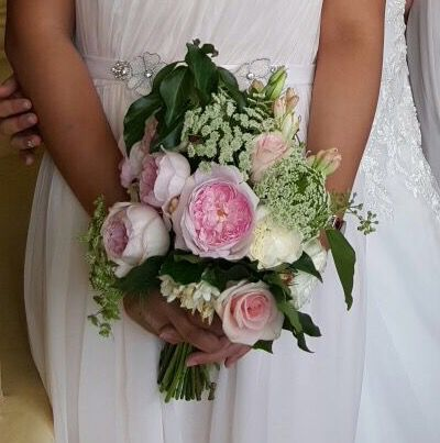 Bridesmaids bouquet. Loving the pink peonies.