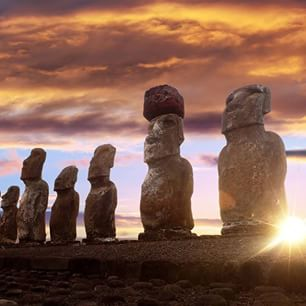 Beautiful sunset over the iconic moai statues on Easter Island. The statues were carved by native tribes between 1250 and 1500!