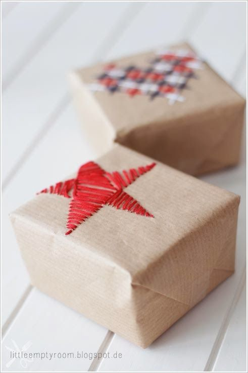 A darling idea! Sweet embroidered gift wrap.