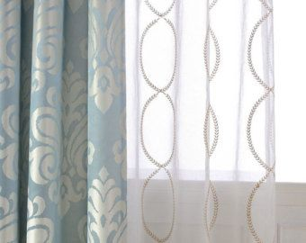 a pair of white sheer curtains made to order upto by