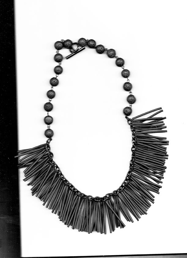 Black plastic laces and lava stones #contemporary #jewelry