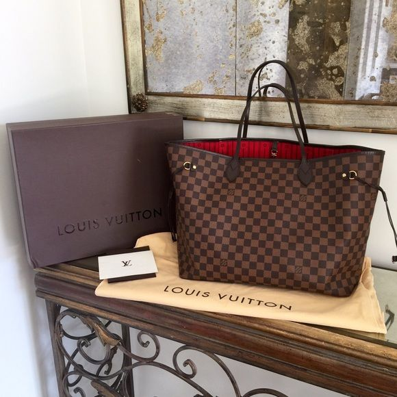 Louis Vuitton Neverfull GM Damier Ebene tote bag Authentic Louis Vuitton Neverfull GM Damier Ebene. Excellent condition. Only signs of wear are light water marks at bottom of bag that may wipe out and 2 small rubbed spots on exterior. Both are shown in photos. Everything else looks really good. I have more photos but I just posted the ones that show the wear. The handles are even in great shape still. Rarely carried! Original receipt & duster included. Box available w/ added shipping cost…